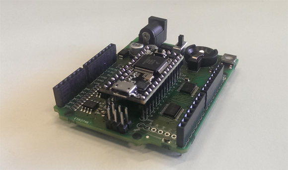 A Teensy 3.0 board mounted on the Teensy-Arduino adapter shield